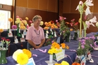 Dannevirke's Margaret Webb is surrounded by blooms at the Woodville Horticultural and Industrial Show on Saturday. Photo / Christine McKay