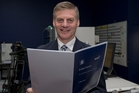 Finance Minister Bill English checks out copies of his 2015 Budget. Photo / Mark Mitchel