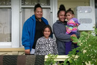 Anita Jones with three of her four children (l-r) Jewel, Shonah and Kevinah on the verandah of their state house in Ponsonby valued at just under $2 million. Photo / Simon Collins