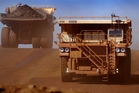 The prices of BHP's four main commodities - iron ore, coal, copper and oil - fell sharply. Photo / Bloomberg