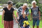 Florence Lumb, 101, in the grounds of Radius Baycare with family friend Doreen Haywood (left) resthome manager Pam Hughes and daughter Sheila Watson of Paihia. Photo / Peter de Graaf