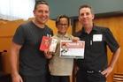 Steve Price, ex-Warriors captain (left), presented the latest award to R J Tauteka, 10, with Darren Huston.