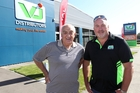 VJ Distributors Ltd co-owners Peter Geor and Craig Bridgman outside their new premises, 10 years to the day the business in Omahu Rd was razed by a massive fire. Photo / Duncan Brown