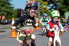 Riley Aitken, 4 (left), and Trey Tarplett, 4, have fun on one of the bike circuits. Photo / Ben Fraser