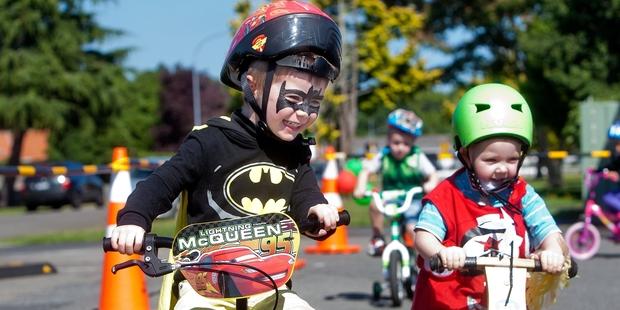 Riley Aitken, 4 (left), and Trey Tarplett, 4, have fun on one of the bike circuits. Photo / Ben Fraser