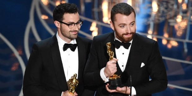 Loading Songwriter Jimmy Napes and singer-songwriter Sam Smith accept the Best Original Song award for Writing's on the Wall from Spectre at the Oscars. Photo / AFP