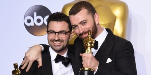 Jimmy Napes and Sam Smith pose with the Oscar for Best Original Song, Writing's on the Wall from Spectre, at the 88th Oscars. Photo / AFP