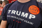 A supporter of Republican presidential candidate Donald Trump wears a sticker and a Trump t-shirt during a rally at Radford University. AP photo / Steve Helber