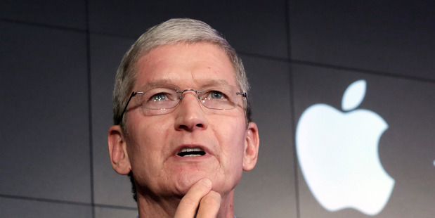 FILE - In this April 30, 2015, file photo, Apple CEO Tim Cook responds to a question during a news conference at IBM Watson headquarters, in New York. Cook said his company will resist a federal magis