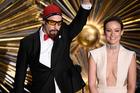 Sacha Baron Cohen, left, appears as Ali G while presenting an Oscar award with Olivia Wilde. Photo/AP