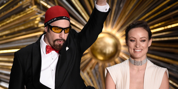 Sacha Baron Cohen, left, appears as Ali G while presenting an Oscar award with Olivia Wilde. Photo/AP