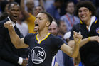 Stephen Curry celebrates his game-winner. Photo / AP