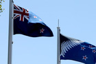 The New Zealand flag and the contender flying at Baycourt in Tauranga. Photo / John Borren, Bay of Plenty Times