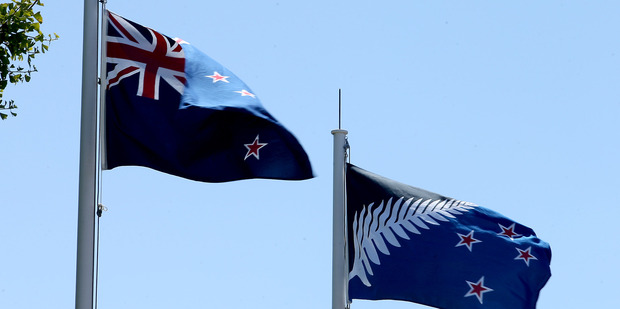 Loading The New Zealand flag and the contender flying at Baycourt in Tauranga. Photo / John Borren, Bay of Plenty Times