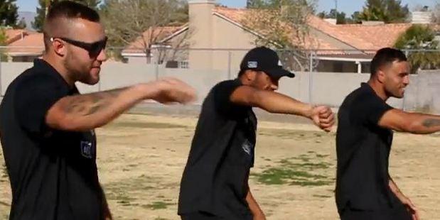 Josh Van Lieshout, Sione Molia and Liam Messam dance off against Vegas schoolchildren. Photo / Youtube