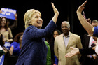 Hillary Clinton high-fives an audience member. Photo / AP