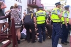 Fourteen people have been injured, eight badly, after a balcony collapsed in Dunedin during a concert by the band Six60.