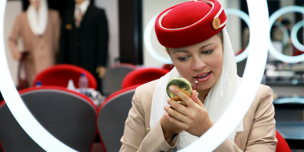 An aircrew student with Emirates Airline applies lip liner during a make-up training session. Photo / Getty Images