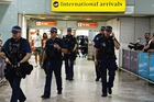Armed police officers at Heathrow Airport in London. Photo / Getty
