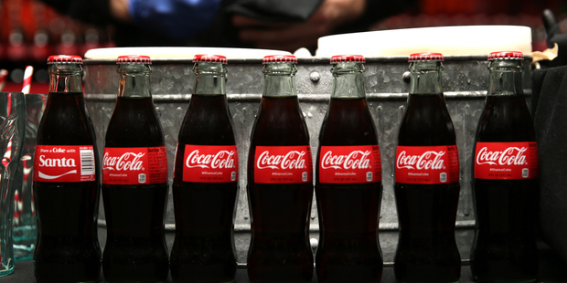 Glass is the least chemically reactive material used to bottle Coke. Photo / Getty