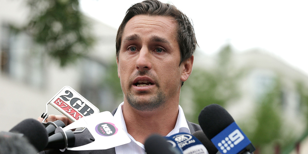 Mitchell Pearce speaks to the media last month. Photo / Getty