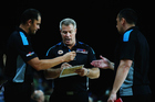 Head coach Dean Vickerman talks with assistant coach Judd Flavell and Paul Henare. Photo / Getty Images