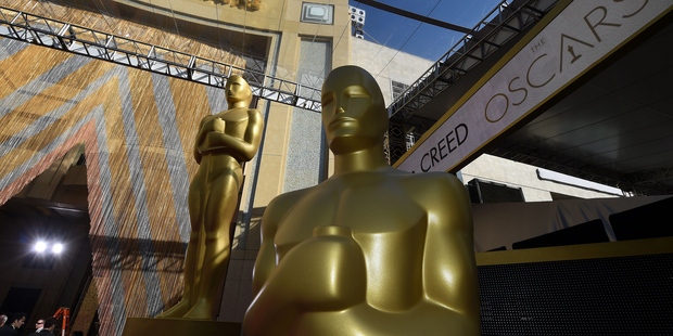 Oscar statues are seen on the red carpet in front of the Dolby Theatre in Hollywood, California, a day ahead of the 88th Academy Awards. Photo / AFP / Mark Ralston via Getty Images