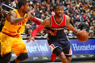John Wall handles the ball against the Cleveland Cavaliers. Photo / Getty Images