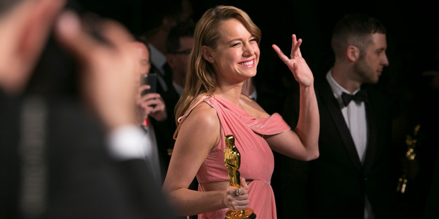 Brie Larson holds her Oscar best actress in her role in Room as she arrives to the 2016 Vanity Fair Oscar Party. Photo / AP