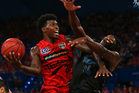 Casey Prather lays up against Charles Jackson during game one of the grand final series. Photo / Getty