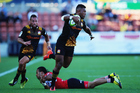 Seta Tamanivalu slips a tackle during the Chiefs' encounter with the Lions in Hamilton. Photo / Getty