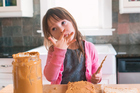 The research suggests that allowing children to get used to nuts early prevents an allergic reaction. Photo / Getty Images