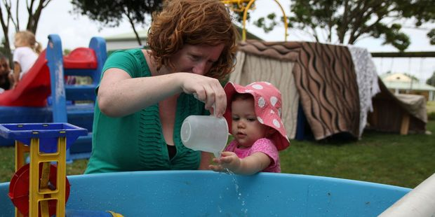 Leah Nakaora and her daughter, Ruth, explore water play at River Downs Playcentre.