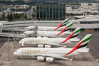 Four Emirates A380s line up on the Auckland Airport tarmac for the first time.