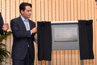 Tauranga MP Simon Bridges unveils a commemorative plaque as he officially opened Trustpower's new headquarters in Durham St tonight