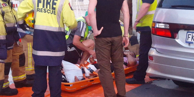 Emergency services attend to people who fell from a collapsed balcony at a Six60 concert in Castle St, Dunedin. Photo / James Gunn