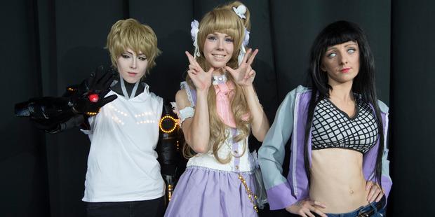L-R Vadim Scanlon as Genos, Kelly Smith as White Day Kotori and Elisha Ward as Hinata Hyuga pose for a photo. Photo / Nick Reed