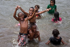 Brett Phibbs captured these happy and resilient children playing in a creek north of Lautoka just days after the country received a hammering from Tropical Cyclone Winston. Photo / Brett Phibbs