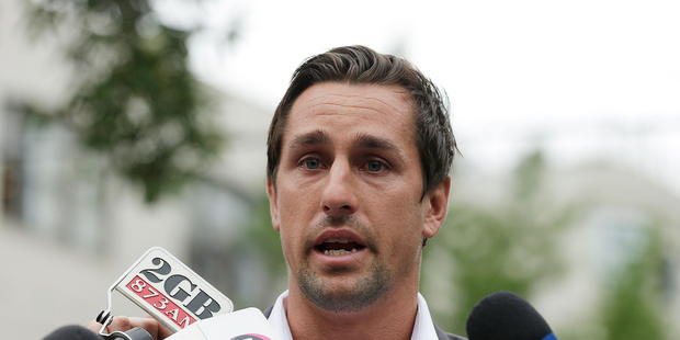 Mitchell Pearce speaks to the media (Photo by Mark Metcalfe/Getty Images)