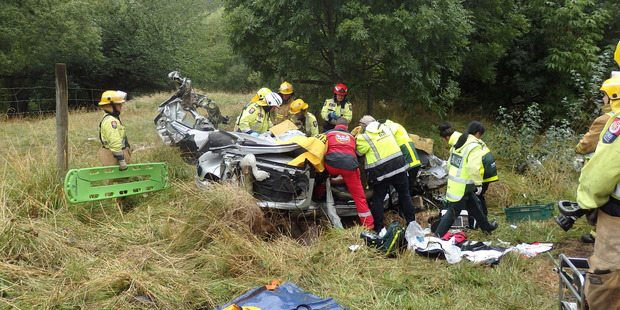 Emergency services attend the fatal crash in Canterbury yesterday. Photo / Christchurch Westpac Helicopter
