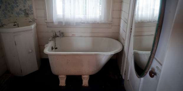 A cute clawfoot bath designed more for cleanliness than comfort.