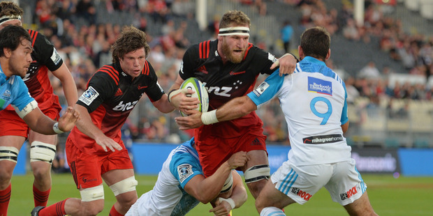 Kieran Read of the Crusaders is tackled during the round two Super Rugby match between the Crusaders and the Blues at AMI Stadium. Photo / Getty Images