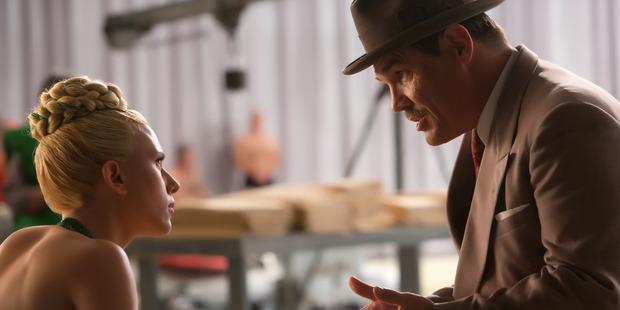 "Scarlett Johansson, left, and Josh Brolin appear in a scene from ""Hail, Caesar!.""."