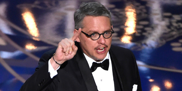 Adam McKay accepts the award for best adapted screenplay for The Big Short at the Oscars. Photo / AP