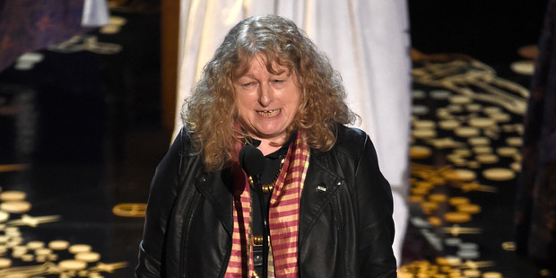 Dressed down in a leather jacket Jenny Beavan accepts the award for best costume design for Mad Max: Fury Road. Photo / AP