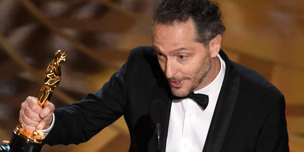 Emmanuel Lubezki accepts the award for best cinematography for The Revenant at the Oscars. Photo / AP