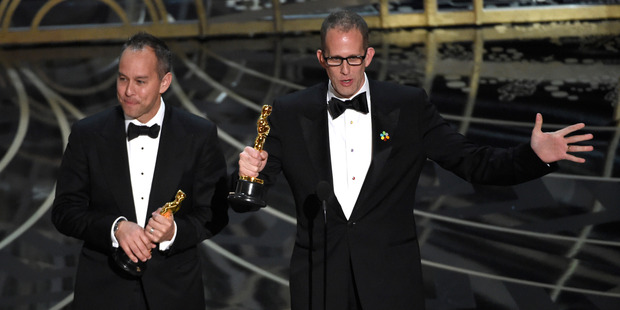 Jonas Rivera and Pete Docter accept the award for best animated feature film for Inside Out at the Oscars. Photo / AP