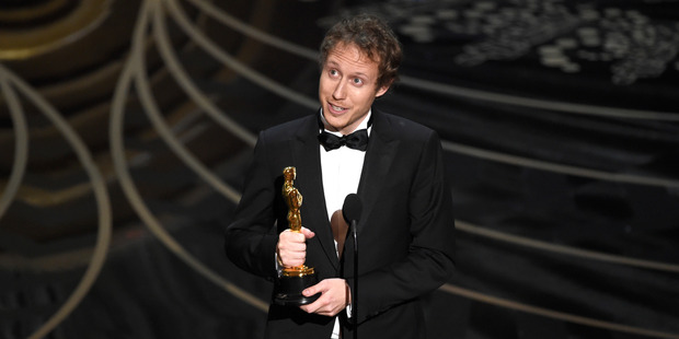 Laszlo Nemes, of Hungary, accepts the award for best foreign language film for Son of Saul at the Oscars. Photo / AP