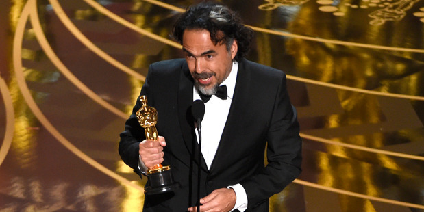 Alejandro G. Inarritu accepts the award for best director for The Revenant at the Oscars. Photo / AP