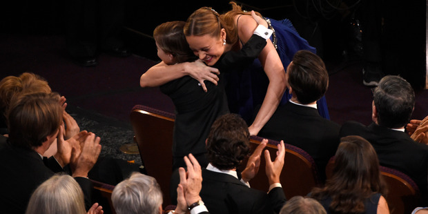 Brie Larson, right, hugs Jacob Tremblay after she wins the award for best actress in a leading role for Room at the Oscars. Photo / AP